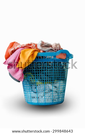 Clothes in blue plastic basket isolated on white background - stock photo