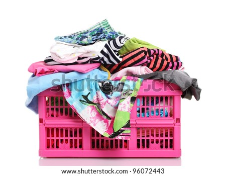 Clothes in pink plastic basket isolated on white - stock photo