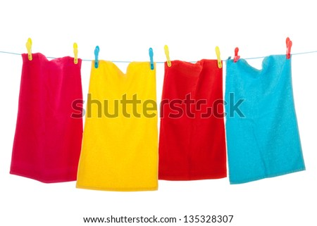 clothes line with colorful towels - stock photo