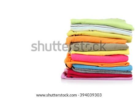 clothes neatly folded on white isolated background - stock photo