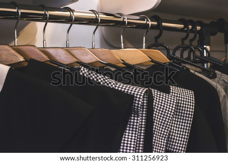 Clothes on hangers in shop. Close up - stock photo
