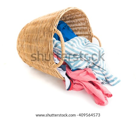 Clothes on wicker baskets for washing preparations whit white background - stock photo
