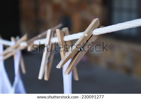 Clothes pins with white bags - stock photo