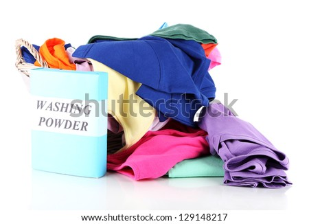 Clothes with washing powder in wooden basket isolated on white - stock photo