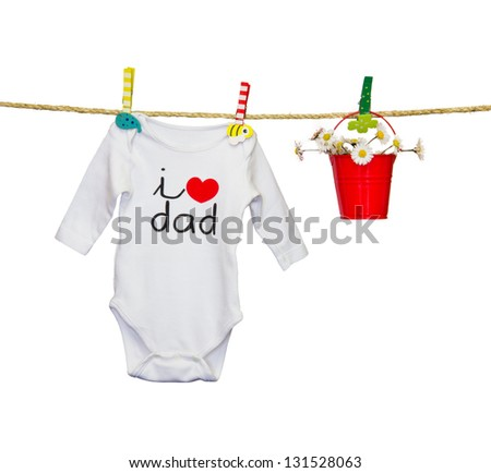 clothesline with a bib and baby clothes - stock photo