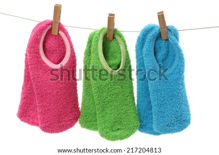 clothesline with a multicolor group of socks  - stock photo