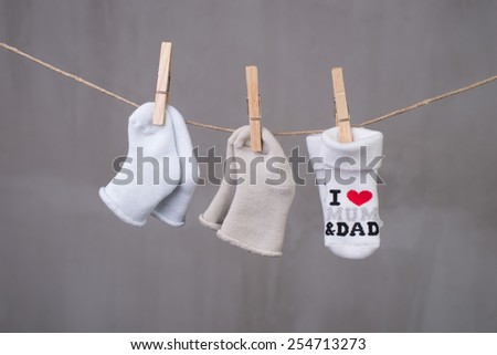 clothesline with baby socks - stock photo