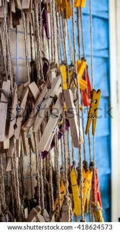 Clothespin clamps together a bunch. - stock photo