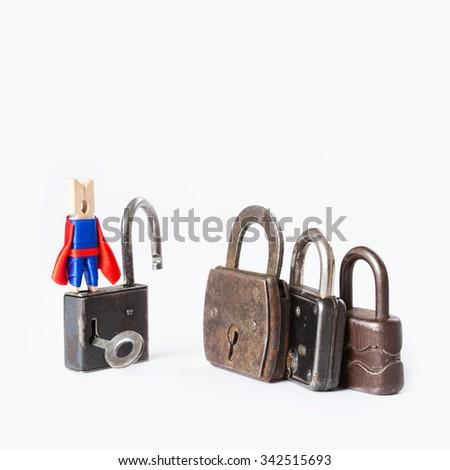 Clothespin superhero housebreaker with opened padlock. Vintage, retro design closed iron padlocks. Opening conceptual photography. White background. copy space. macro view - stock photo