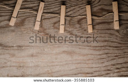 clothespins on rope - stock photo