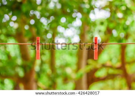 Clothespins on rope, Wooden Clothes Pin on Clothes Line. - stock photo