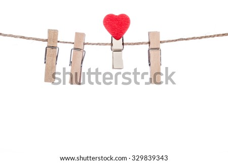 clothespins with heart  shape  clip on a clothesline, valentine romantic - stock photo
