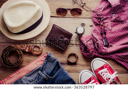 Clothing and accessories for womens on wood floor - stock photo
