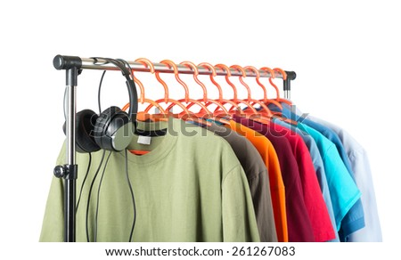 Clothing and headphones on the hanger, white background. - stock photo