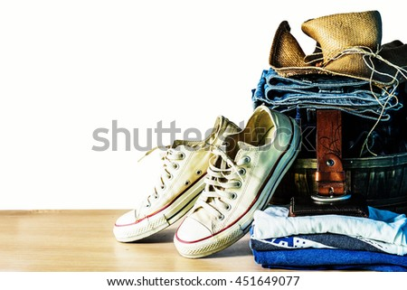 Clothing and shoes on the wooden - stock photo