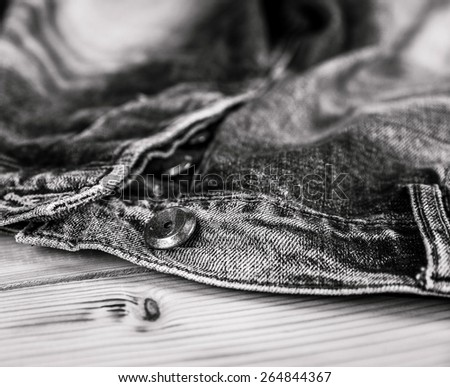 Clothing. jeans and a button in the foreground - stock photo