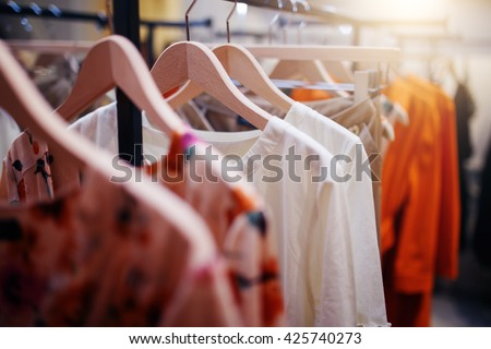 Clothing on hanger at the modern shop boutique - stock photo