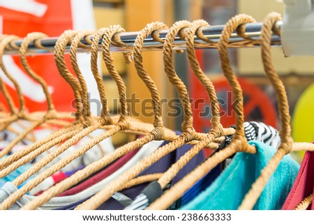 Clothing on hangers at a store in a night market - stock photo