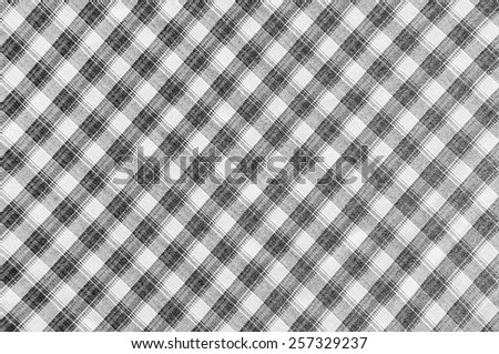 Clothing surface grid pattern in black and white. - stock photo