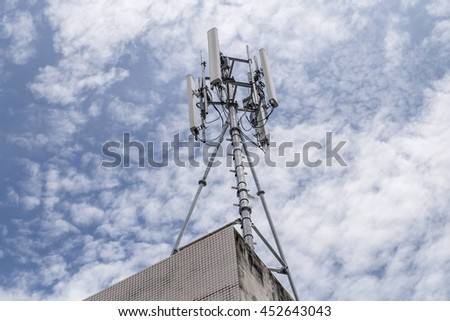 cloud and sky in evening with communications tower pole mobile internet wifi  - stock photo