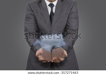 Cloud computing, close up of male hand holding cloud with copy space - stock photo