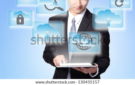 Cloud computing concept - Business man touch tablet pc with cloud computing icon in the air - stock photo