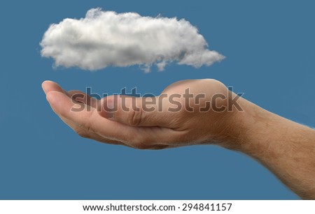 Cloud computing concept, close up of cloud over hand - stock photo