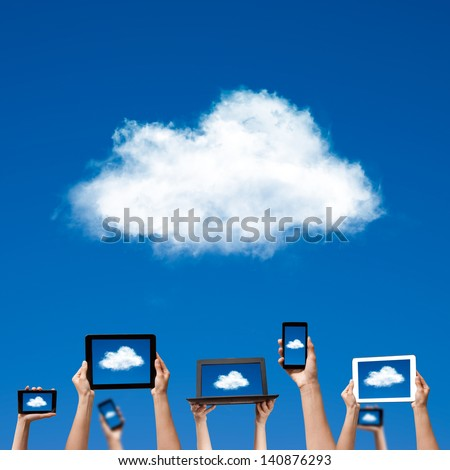 cloud computing concept. hands holding computer laptop smart phone tablet and touch pad - stock photo
