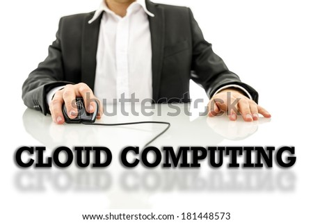Cloud computing text on a reflective surface with a businessman using a wired computer mouse in the background conceptual of an online database and global connectivity. - stock photo