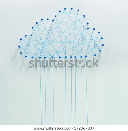 Cloud computing. Wired cloud made out of threads and pins - stock photo