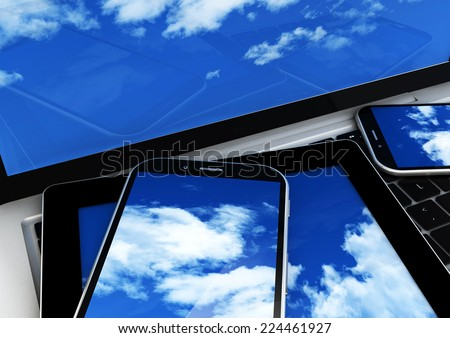 cloud concept: close-up view of devices with sky on the screen - stock photo