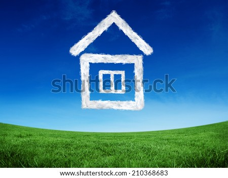 Cloud house against green field under blue sky - stock photo