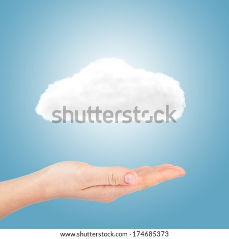 Cloud in hand on blue background - stock photo