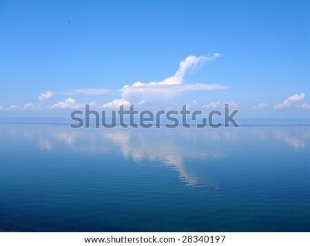 Cloud over water, lake Baikal, Russia - stock photo