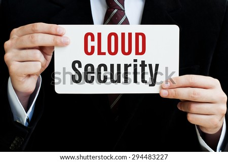 Cloud Security written on card in hands - stock photo
