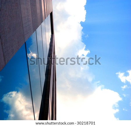 cloud sky reflections on the business building - stock photo