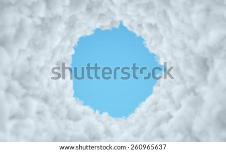 Cloud Tunnel reveling blue sky - stock photo