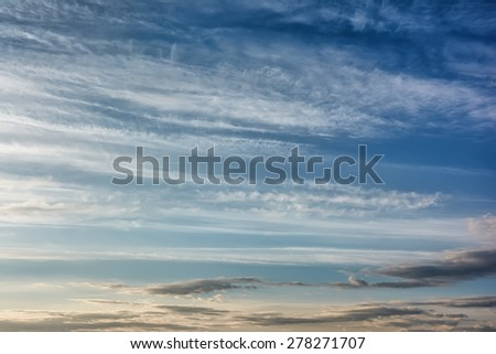 Clouds and blue sky at sunrise - stock photo
