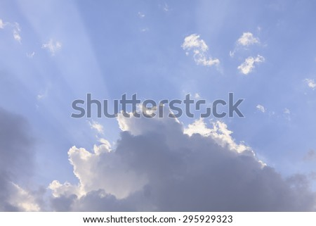 Clouds and Blue Sky with Ray of Light Background texture. - stock photo