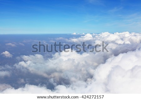 Clouds and dramatic sky, an airplane view - stock photo