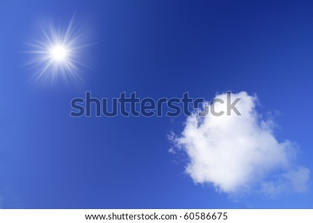 Clouds and sun on the blue sky - stock photo