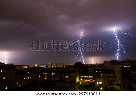 Clouds and thunder lightnings and storm over city. - stock photo
