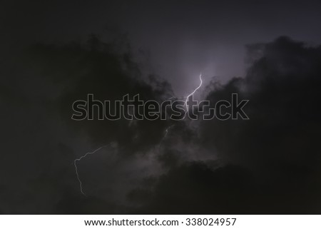 Clouds and thunder lightnings before storm in Thailand - stock photo