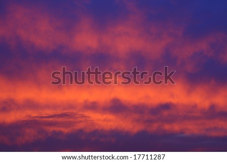clouds at the sunset as a background - stock photo