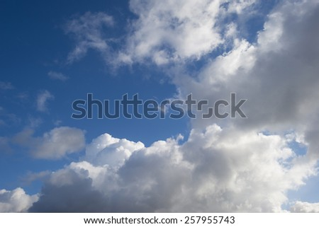 Clouds in a blue sky in winter - stock photo
