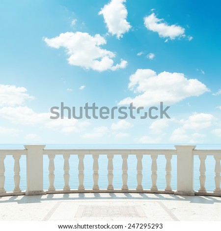 clouds in blue sky over balcony - stock photo
