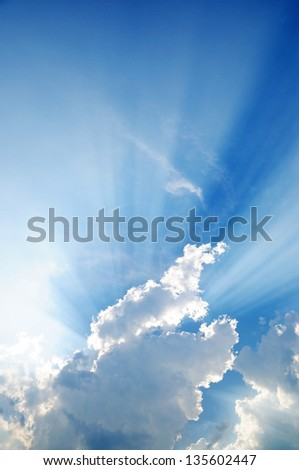 clouds in blue sky with sunrays - stock photo