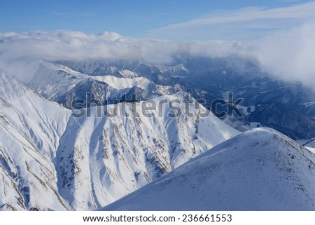 Clouds in the Georgia mountains - stock photo