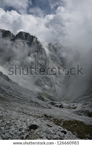 Clouds in the mountains - stock photo