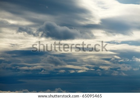 Clouds in the overcast sky - stock photo